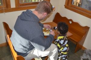 Sharing Daddy's breakfast