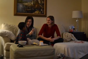 Trying to convince Mimi or Aunt Rachel to give him wine.